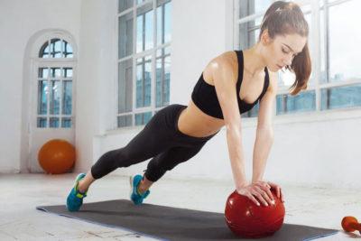 woman medicine ball plank